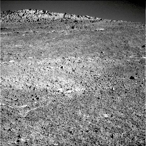 Opportunity's right-hand Pancam images a target dubbed Cape Upright; in the background, part of the McClure-Beverlin escarpment lies on the skyline.