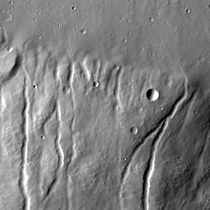 Multiple channels dissect the northern flank of Ceraunius Tholus in this VIS image