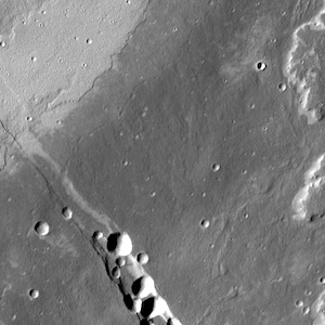 Collapse pits and lava flows flows on Alba Mons