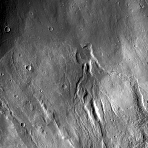 Multiple channels dissect the northwestern flank of Hecates Tholus in this VIS image