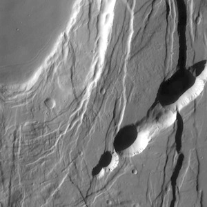 Faults and pit craters in Ceraunius Fossae