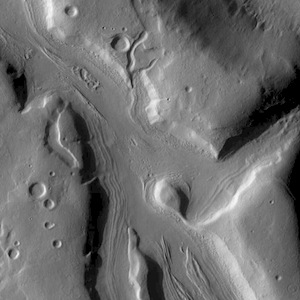 Channels of Coloe Fossae (THEMIS_IOTD_20140722)