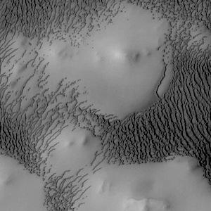Polar dunes swarm around hills (THEMIS_IOTD_20140721)