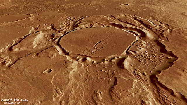 Perspective_view_of_eroded_crater_in_Mangala_Valles