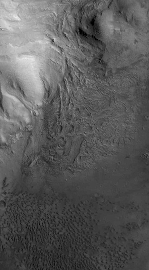 Mantled central peak in Moreux Crater (THEMIS_IOTD_20160118)
