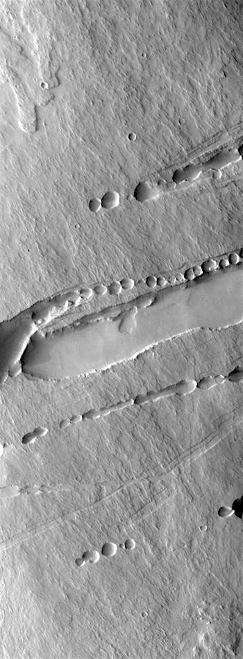 Collapsed lava tubes on Pavonis Mons (THEMIS_IOTD_20171103)