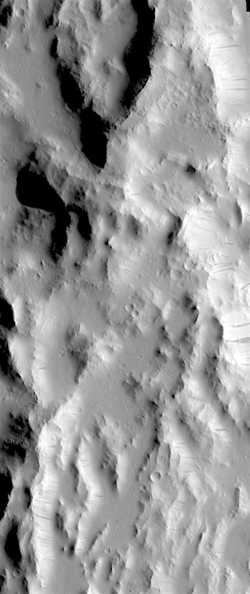 Dark slope streaks on rugged terrain (THEMIS_IOTD_20180531)