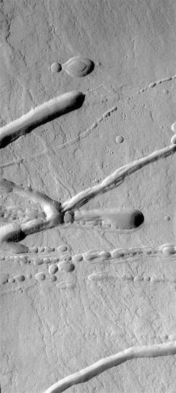 Pits and channels on Ascraeus Mons (THEMIS_IOTD_20180829)