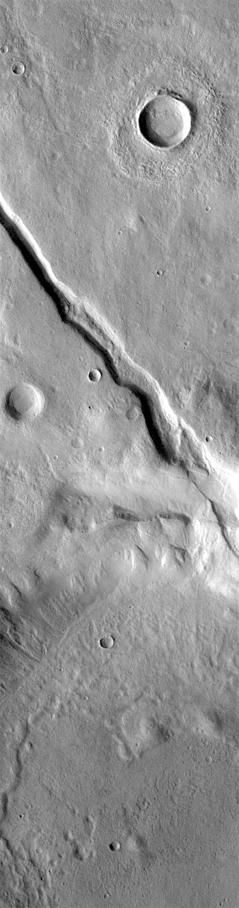 Faults cut a crater in Claritas Fossae (THEMIS_IOTD_20181207)