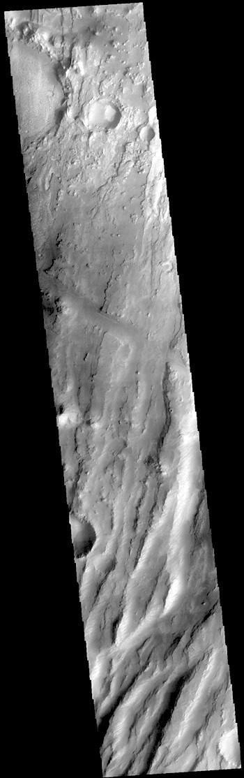 Tectonics meets volcanism in Claritas Fossae (THEMIS_IOTD_20190110)
